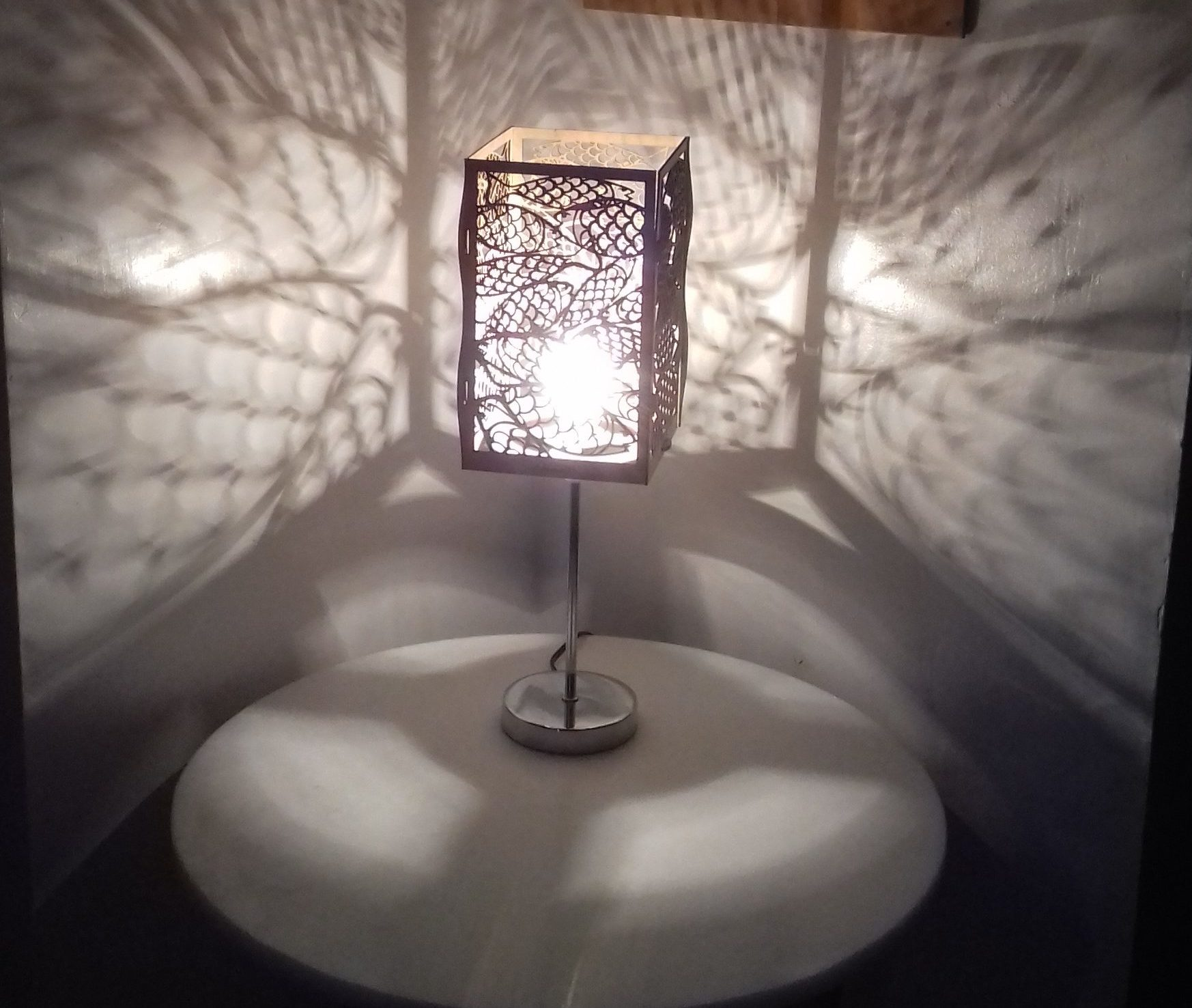 Laser cut fish lampshade made by Izzy at MakerSpace