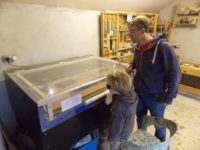 Father and son laser cutting at the Maker Space