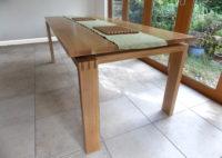 Dining table in oak: Designer/Maker Aaron Moore